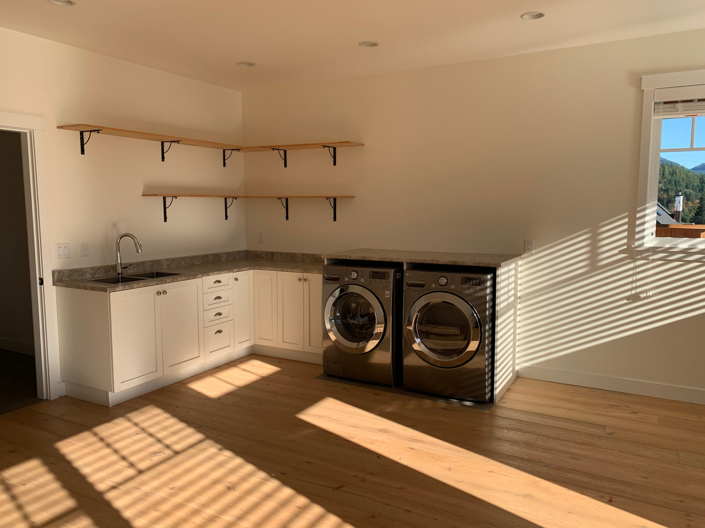 Laundry room with sun shining in