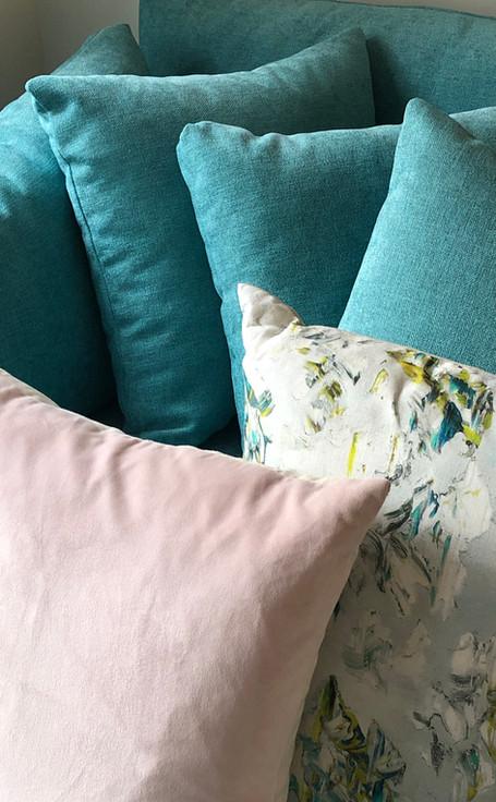 Various cushions and sofa