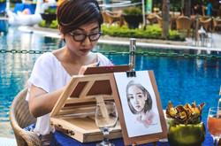Steph Alvarez doing live portrait painting all throughout the event