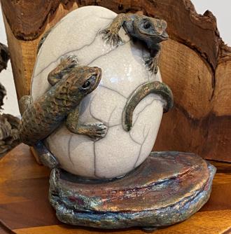 Two raku fired lizards on egg