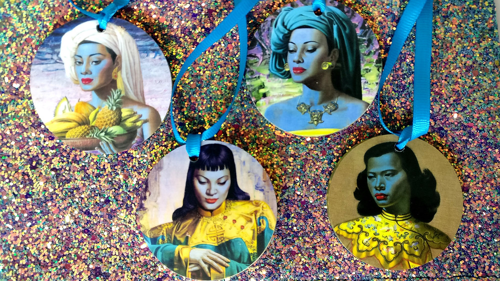 Happy Kitch-mas! Vladimir Tretchikoffs artwork creates a wonderful set of colourful tree decorations.