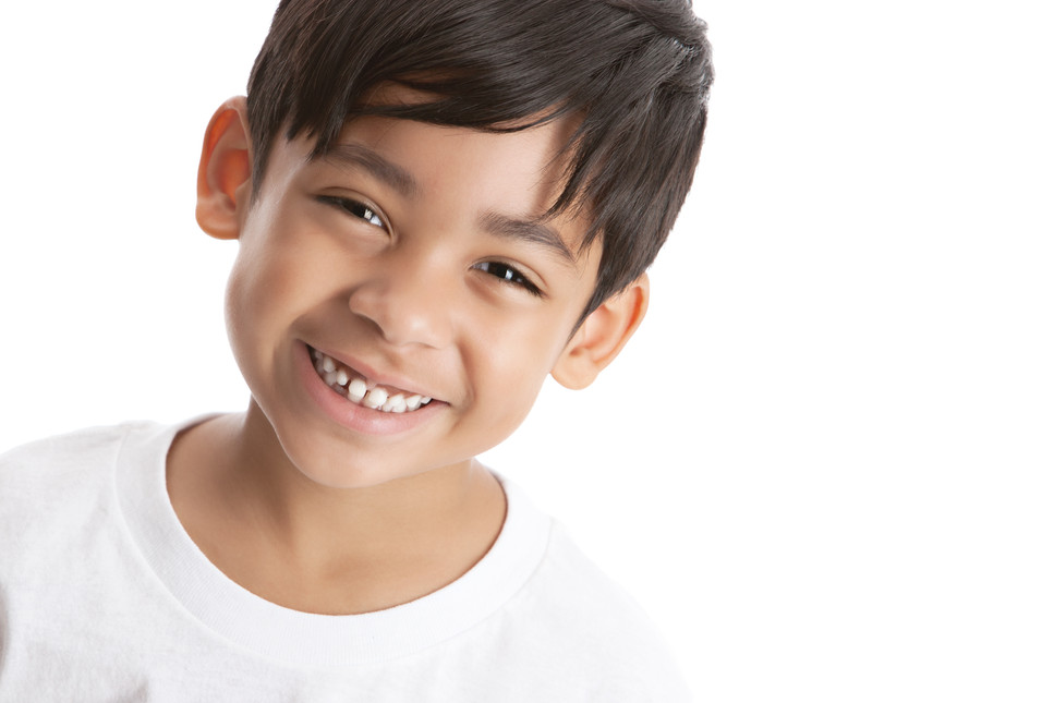 Portrait of a smiling mixed race boy.  I