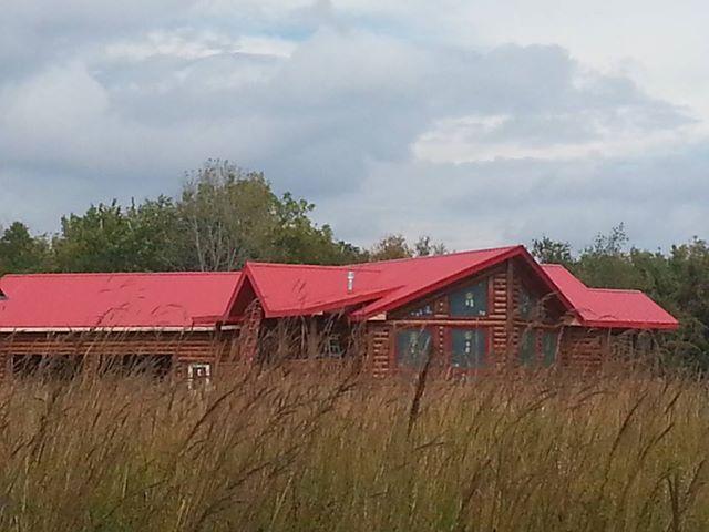 Log Home red roof.jpg