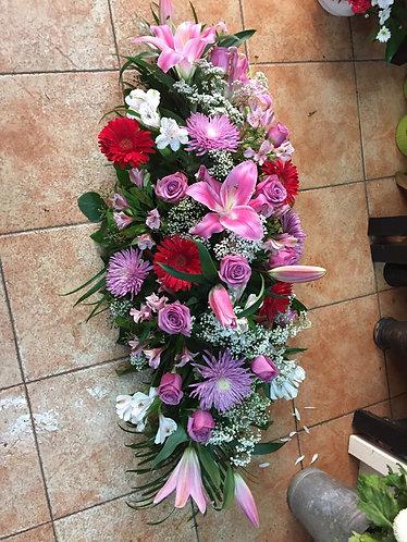 Almohadón funerario en tonos variados
