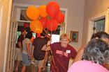 Linda gives away balloons