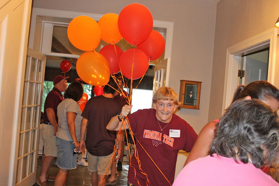 Linda gives away balloons