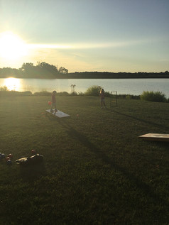 Sunset and Cornhole by the lake