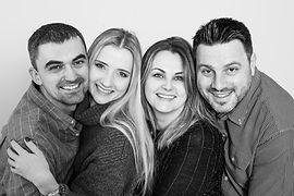 A family huddle photo, black and white