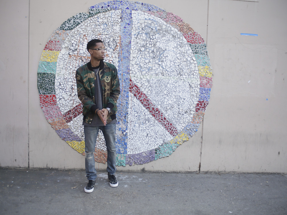 Jhawk Standing In Front Of Peace Sign