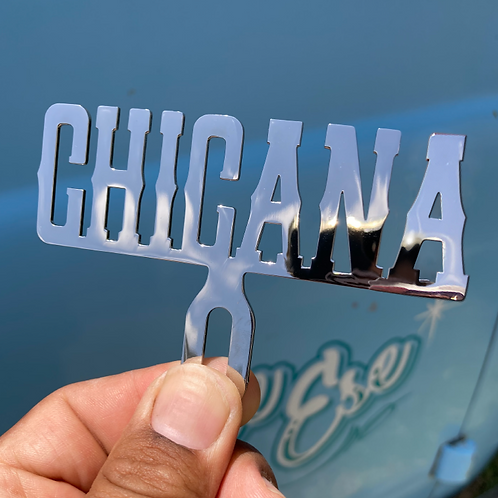 Chicana lowrider license plate topper