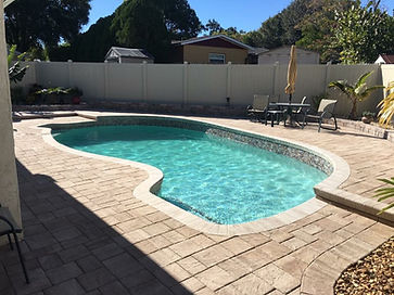 Quartz finish and paver pool deck