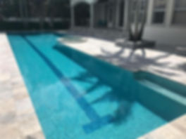 pebble pool finish and silver travertine pool deck