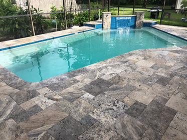 Pebble pool finish and enhanced silver travertine deck