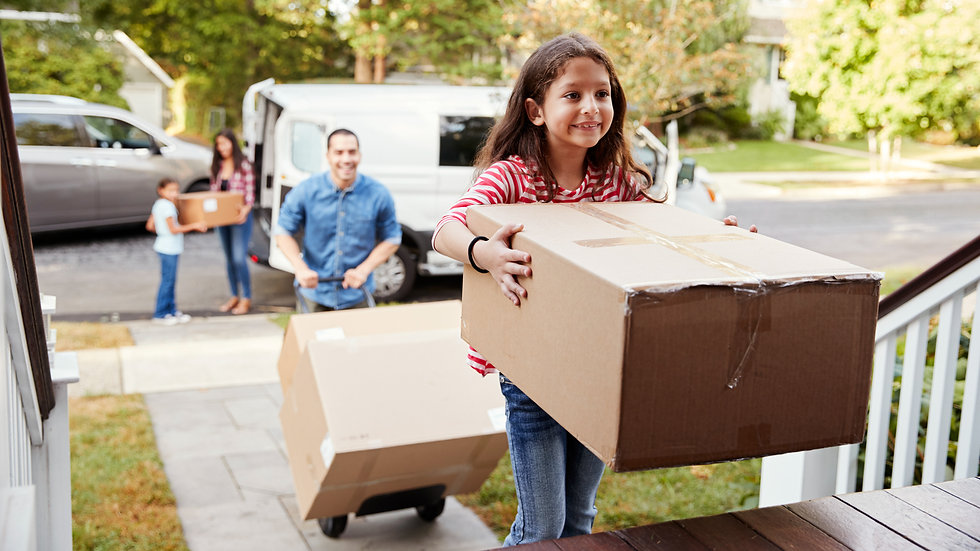 Children-Helping-Unload-Boxes-From-Van-O