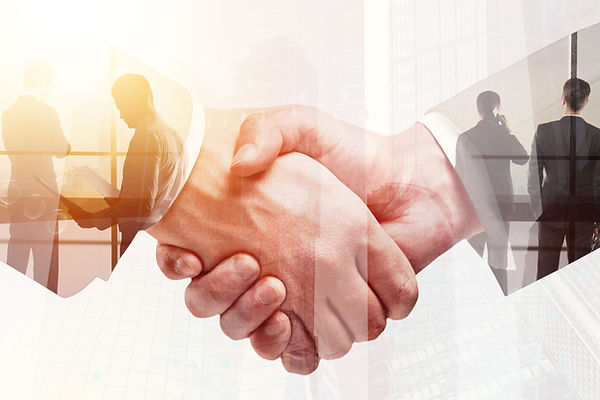 Handshake on abstract city background. T