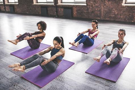 bigstock-Group-Yoga-Training-227958703.j