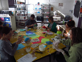 Colleagues work together at Art House to create art.