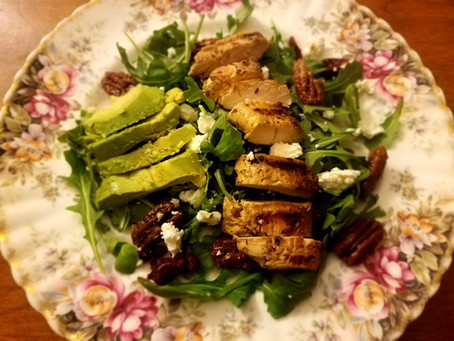 Arugula Salad with Avocado, Goat Cheese, Candied Pecans, and Dried Cranberries