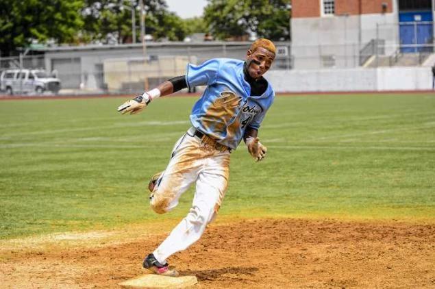 Baseball player running to 3rd base