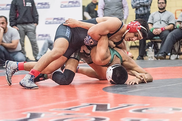 Two students wrestling