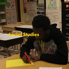 Social Studies - student making a poster