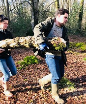 Adult withautism frm Stuarts House Care, New Forest helping to carry logs