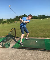 Adult with autism from Stuarts House Care, New Forest learning to play golf