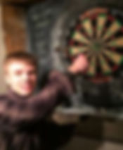Adult with autism Stuarts House Care, New Forest learning to ply darts in the pub