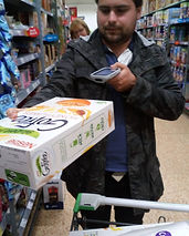 Adult with autism scanning shopping