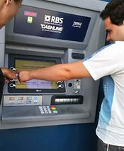 Adult with autism learning to withdrw mony from an atm