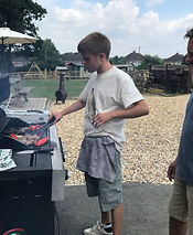 Adult with autism cooking bbq at Stuarts House Care, New Forest