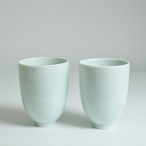 A pair of cups in celadon