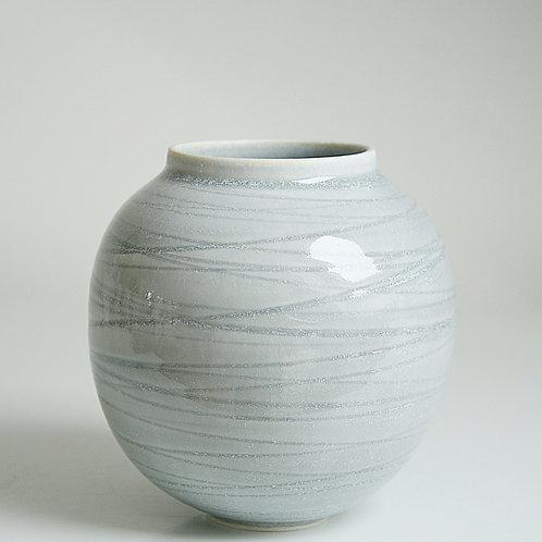 A moon jar in grey