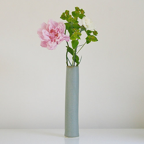 A cylinder vase in blue-grey