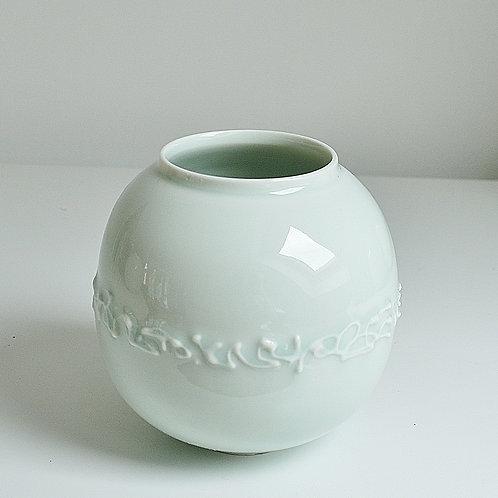 A moon jar in celadon