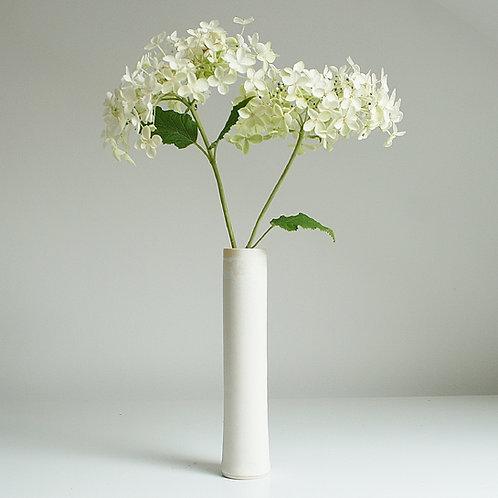 A cylinder vase in cream