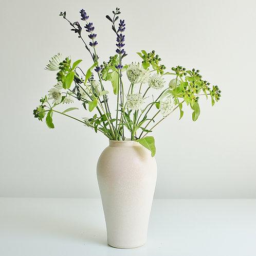 A medium vase in speckled cream