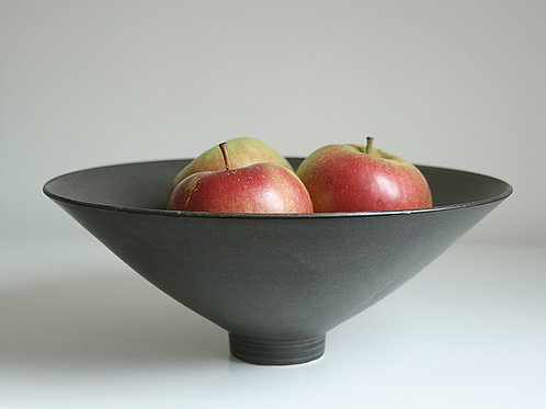 A large bowl in dark grey