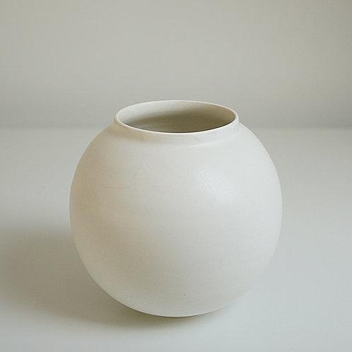 A moon jar in cream