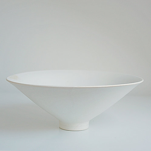 A medium bowl in cream