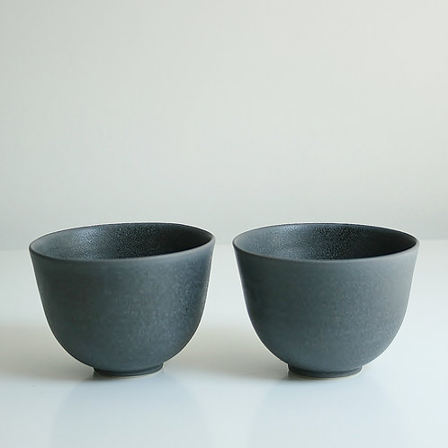 A pair of cups in dark grey