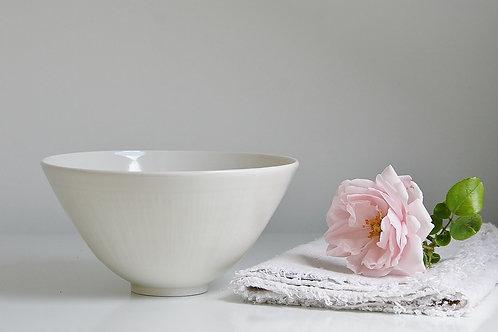 A small bowl in cream