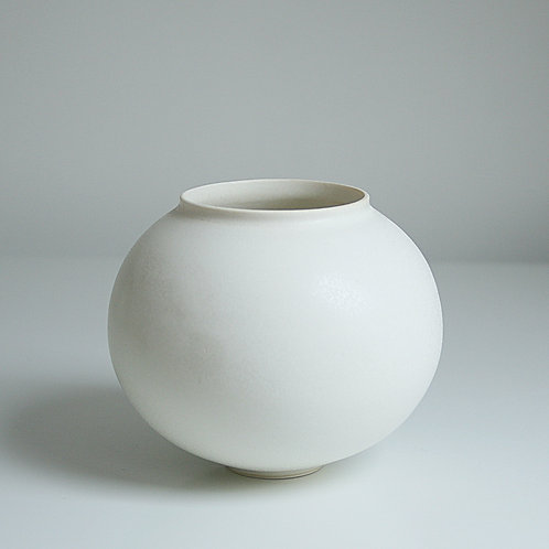 A small moon jar in cream