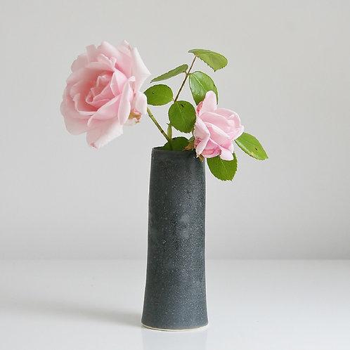 A cylinder vase in dark grey