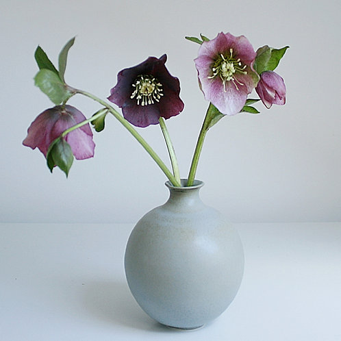 A bud vase in blue-grey
