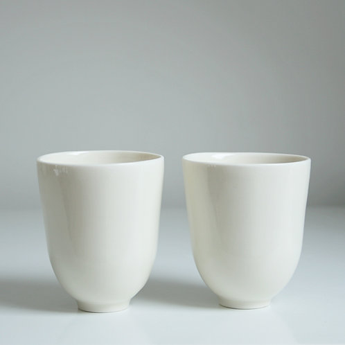 A pair of cups in cream