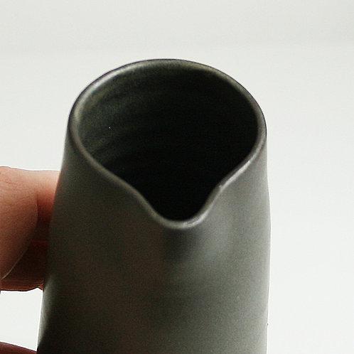 A pourer in dark grey