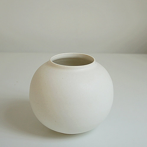A small moon jar in cream