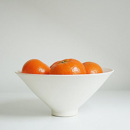 A medium bowl in cream