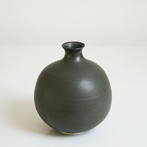 A bud vase in dark grey